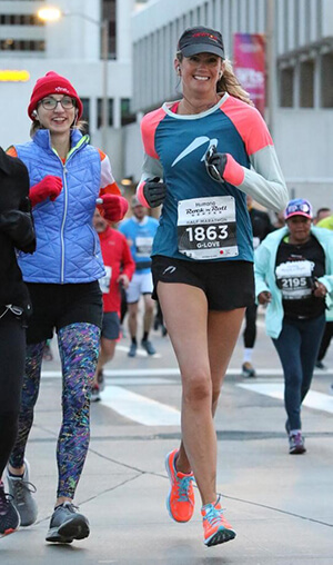 Gretchen-Schoenstein-smiling-while-running-in-a-race