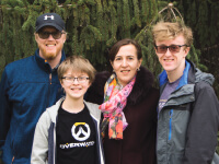 Elena's family has been extremely helpful through her experience and supports her positive approach. Pictured from left, Elena's husband, Charlie, son Ian, Elena, and son Peter.