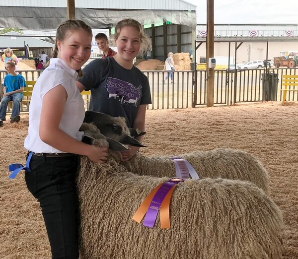 Megan-and-Madeline-Coder-Showing-Sheep-and-Smiling